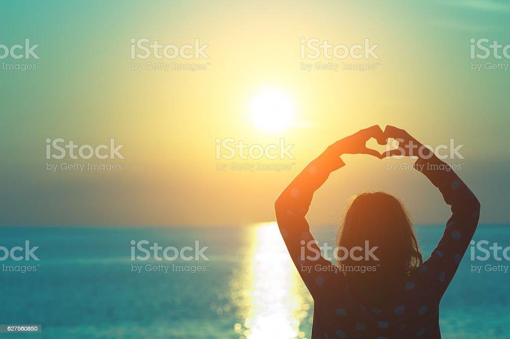 Enjoying the ocean and sunset. stock photo