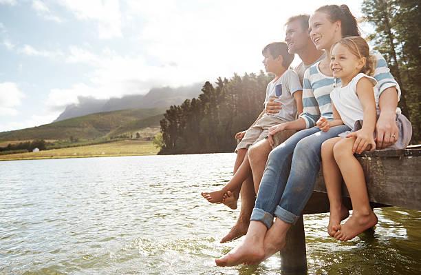 enjoying the outdoors together - flod vatten brygga bildbanksfoton och bilder