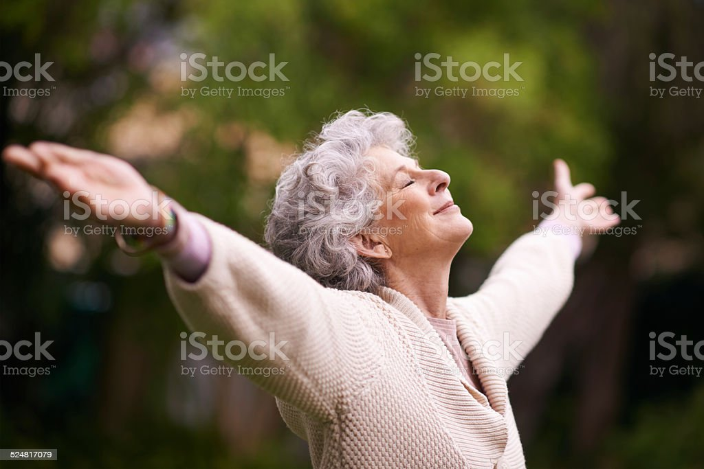 Enjoying the peace and tranquility of her garden stock photo