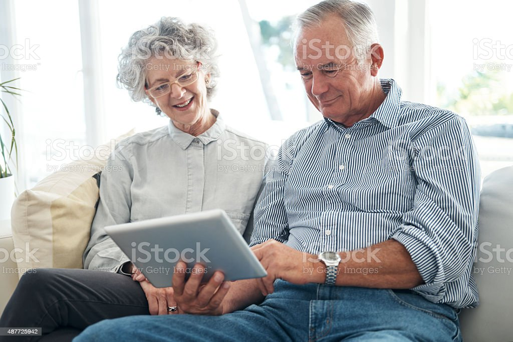 Enjoying the perks of modern technology - Royalty-free 2015 Stock Photo