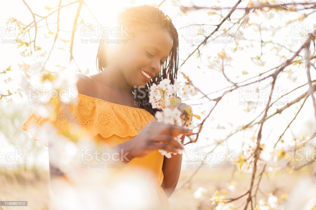 Enjoying The Scents Of Spring Stock Photo - Download Image