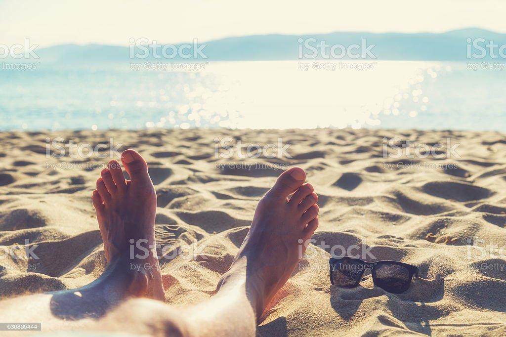 Enjoying the sea / ocean. Focus is on the feet. stock photo