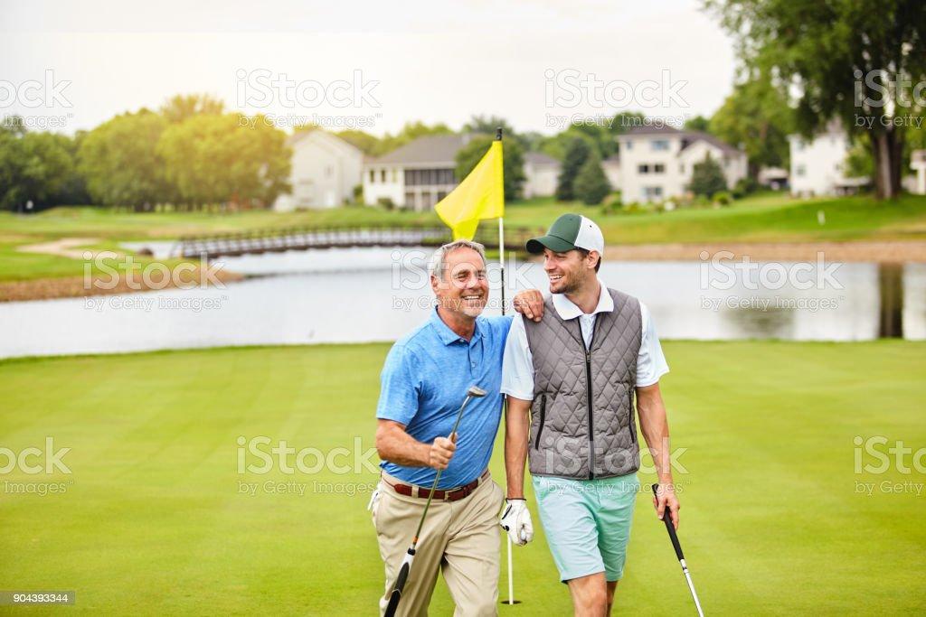 Enjoying the social aspect of golf stock photo