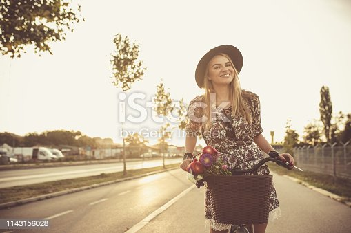 Young lady on a bike driving in a park