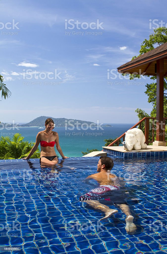 Enjoying the swimming pool of a tropical villa royalty-free stock photo