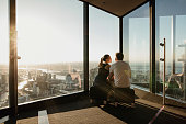 Young couple enjoying the view from the Eureka Skydeck in Melbourne, Australia.