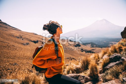 Young Latin woman enjoying the view to Popocatepetl volcano