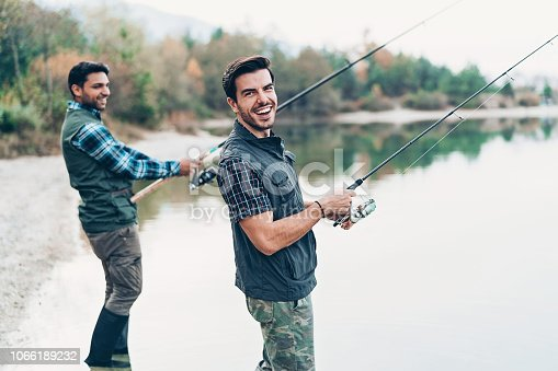 Two men fishing by the river