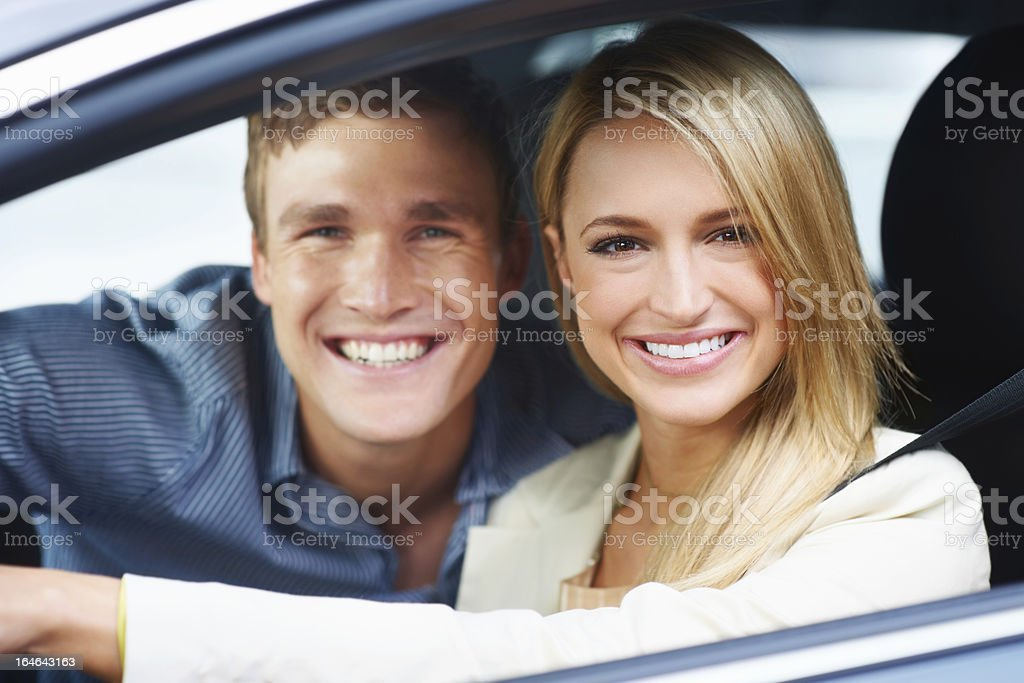 Enjoying their new car to the fullest royalty-free stock photo
