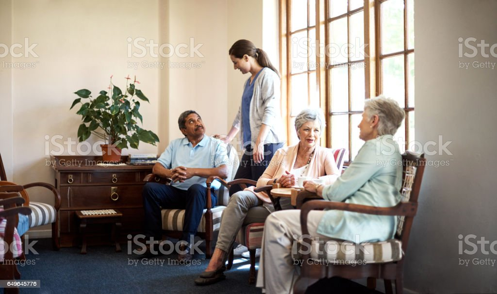 Enjoying their senior years in great comfort and care stock photo