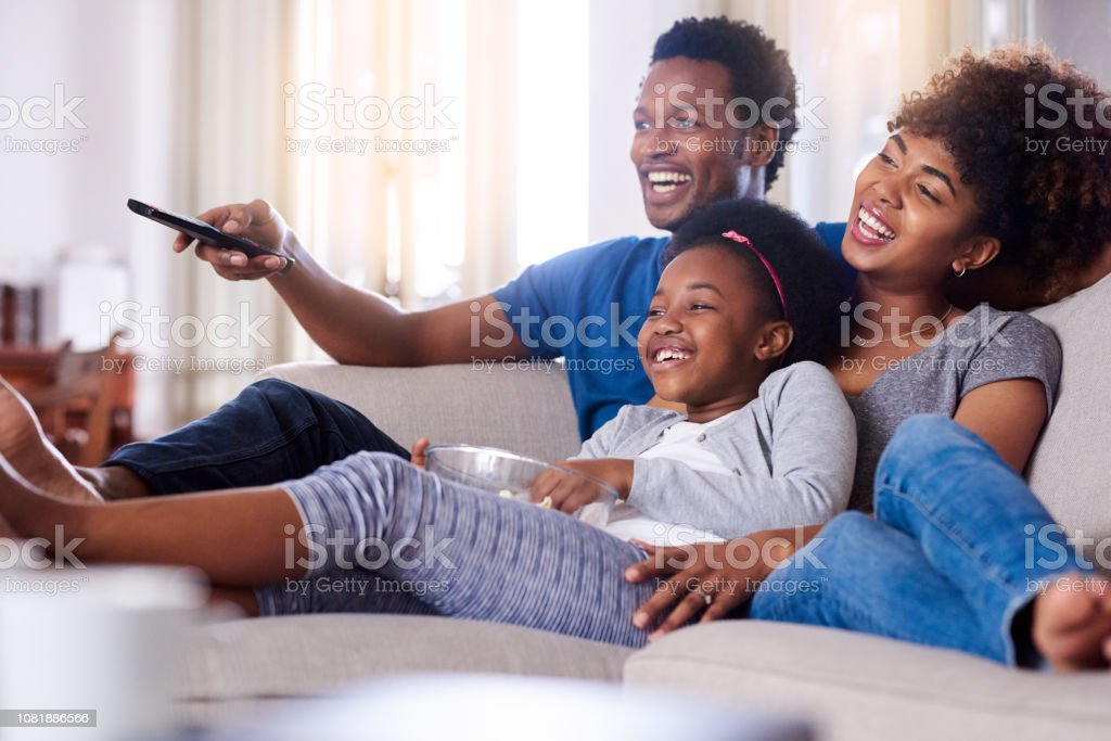 Enjoying tons of family-friendly shows together stock photo