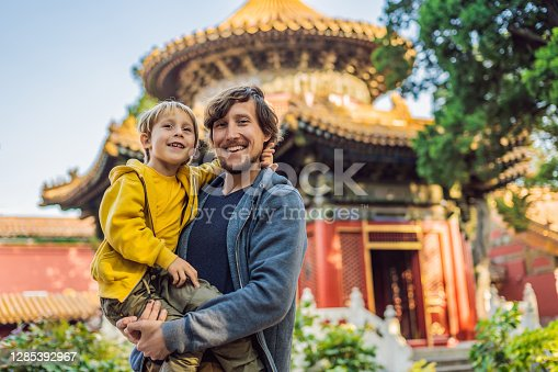 Enjoying vacation in China. Dad and son in Forbidden City. Travel to China with kids concept. Visa free transit 72 hours, 144 hours in China.