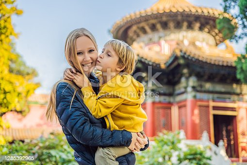 Enjoying vacation in China. Mom and son in Forbidden City. Travel to China with kids concept. Visa free transit 72 hours, 144 hours in China.