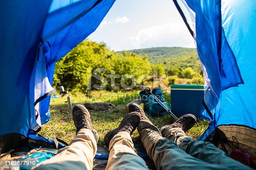 497486952 istock photo Enjoying view from tent 1182877910