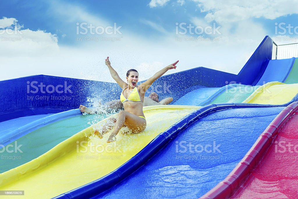 enjoying water slide royalty-free stock photo