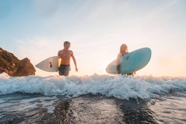 Enjoying weekends by surfing. stock photo