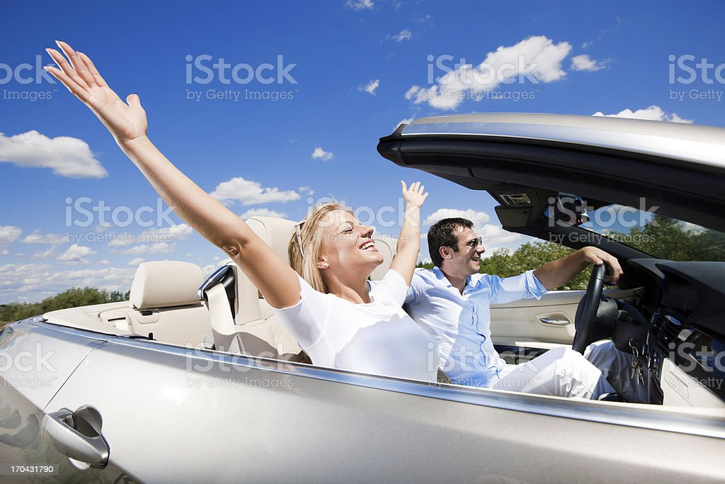 Enjoying your life in a cabriolet car! royalty-free stock photo