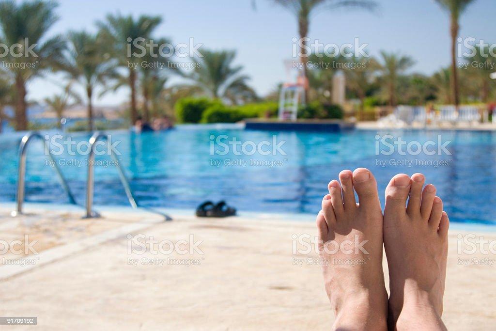Enjoyment near the pool. stock photo