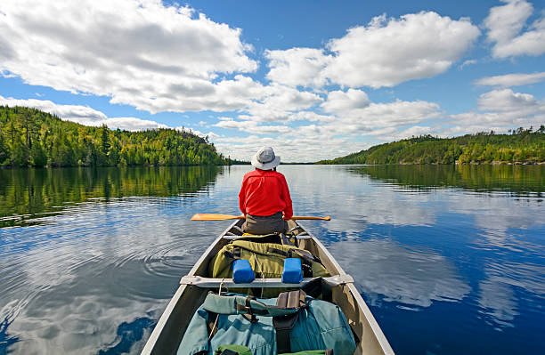 Enjoyng the Wilderness Canoer on Kekekabic Lake in the Boundary Waters in Minnesota minnesota stock pictures, royalty-free photos & images