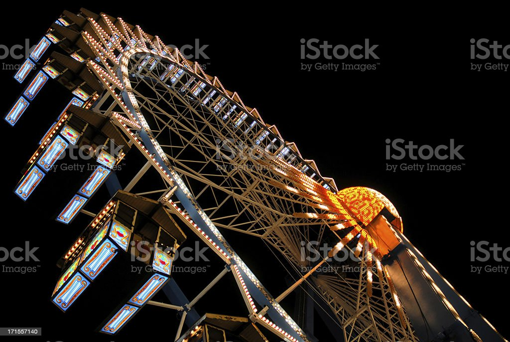 Enlightened giant wheel at night royalty-free stock photo