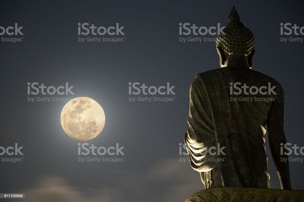 Enormous Buddha statue and moonlight stock photo
