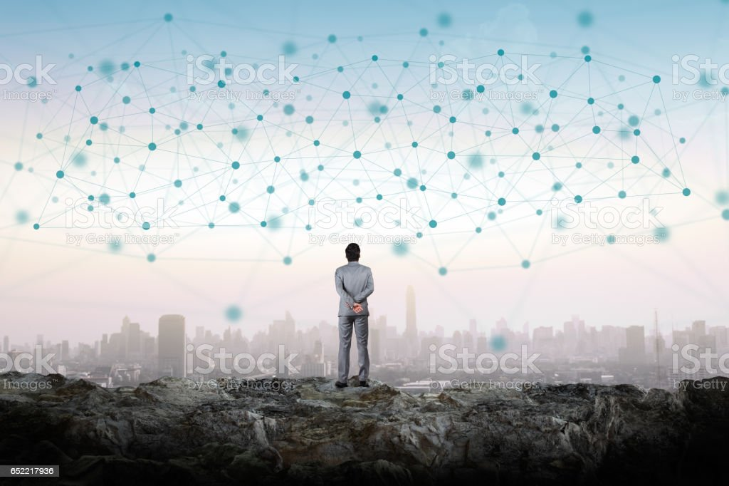 Enormous network. Businessman looking at the enormous network. Abstract Stock Photo