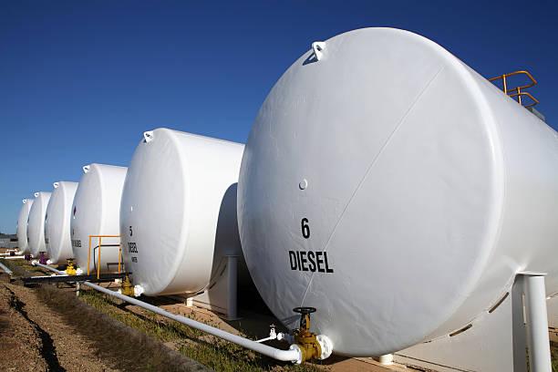 enormous white diesel fuel tanks lined up in houston, texas - brandstoftank stockfoto's en -beelden