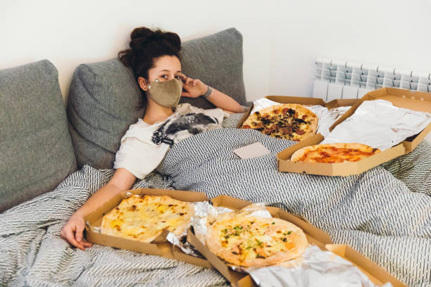 Enough pizza for staying at home and watching movies! stock photo