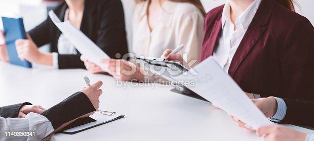 istock enrollment board education student filing documents 1140330341