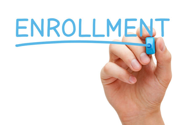 enrollment handwritten with blue marker - open enrollment stock photos and pictures