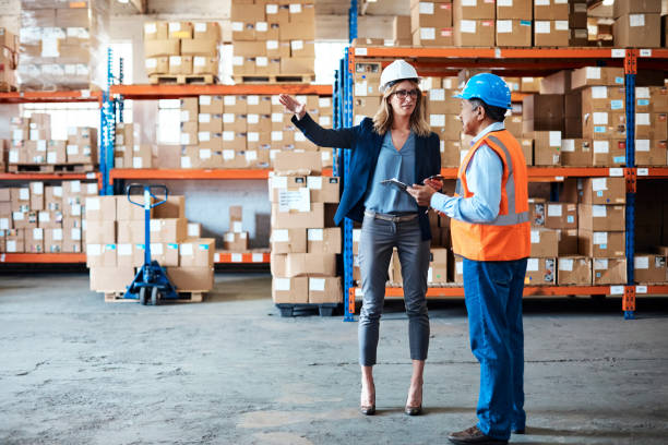 Ensuring all goods are stored appropriately Shot of a man and woman having a discussion while working together in a warehouse appropriately stock pictures, royalty-free photos & images