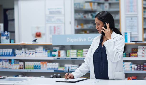 Ensuring all stays in order at her pharmacy stock photo