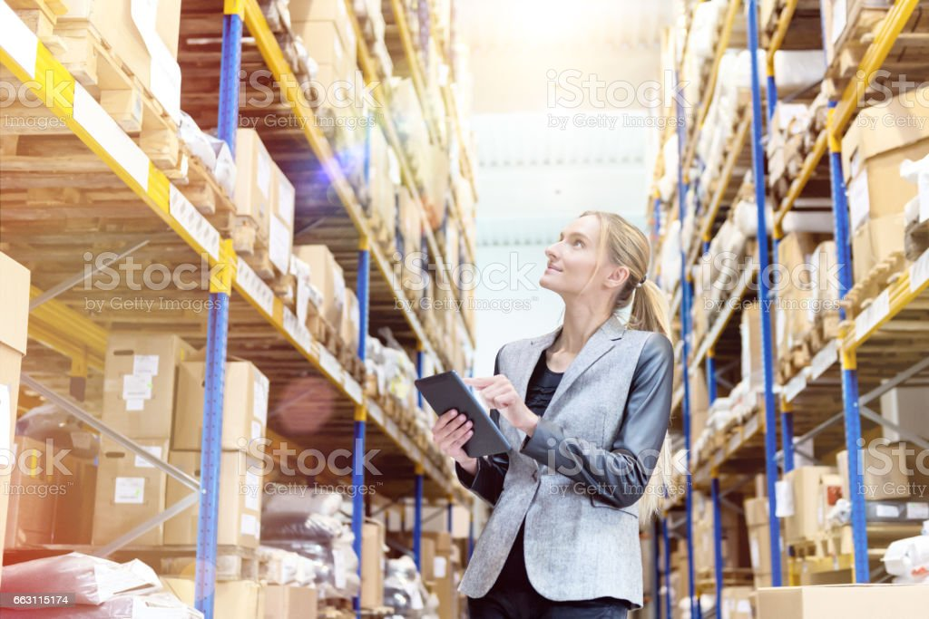 Ensuring deliveries in distribution warehouse stock photo