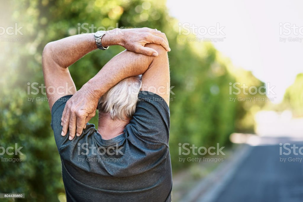 Ensuring less chance of injury during his workout stock photo