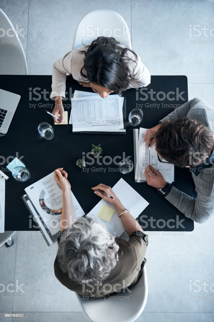 Ensuring they're all on the same page stock photo