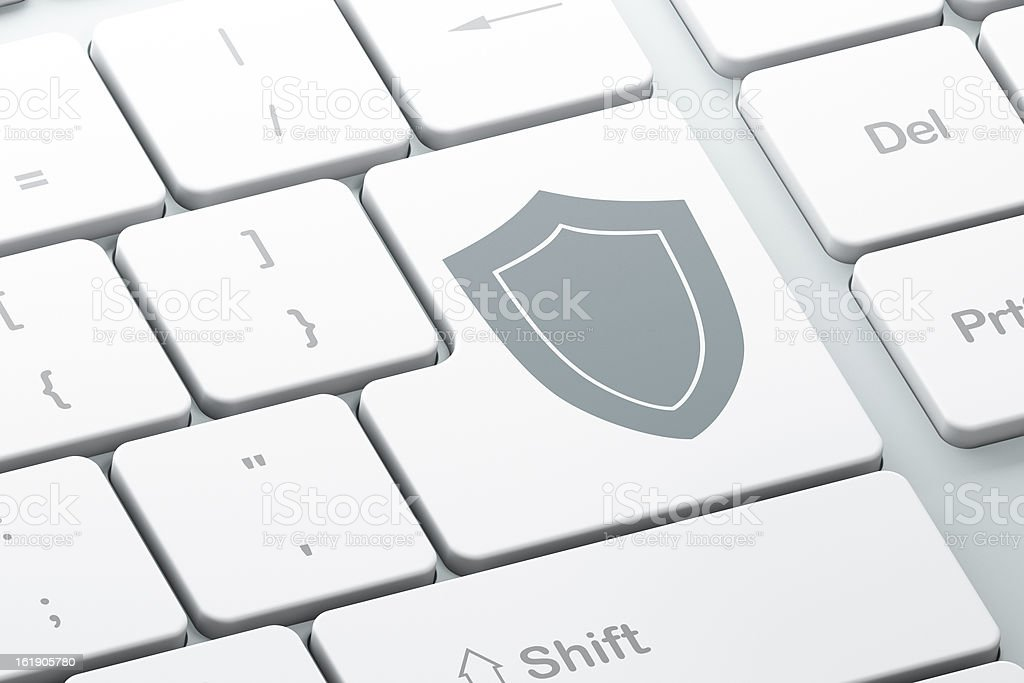 Enter button with shield on computer keyboard royalty-free stock photo