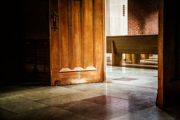 Enter Here The doors are open and inviting one in. pew stock pictures, royalty-free photos & images