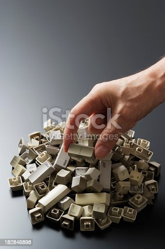 istock Enter key from a broken computer keyboard in hand 182846898