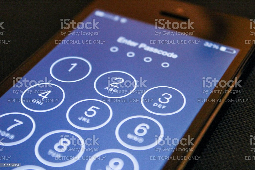 """Enter passcode on the iOS 8 iPhone 5 Eastboune, United Kingdom - September 22, 2014: """"Enter Passcode"""" screen on the iPhone 5 running the iOS 8. Apple Computers Stock Photo"""