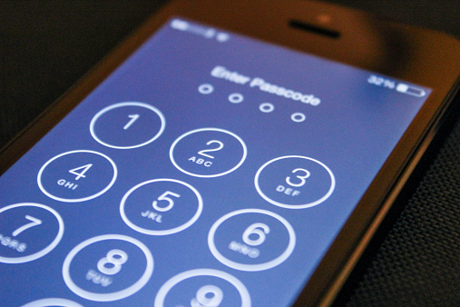 Enter Passcode On The Ios 8 Iphone 5 Stock Photo - Download Image Now