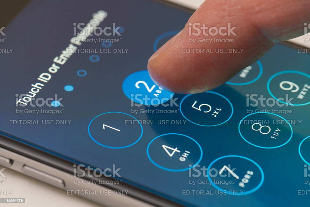Enter passcode screen of an iPhone running iOS 9 stock photo