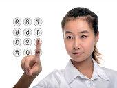 A businesswoman entering Password on virtual keypad.
