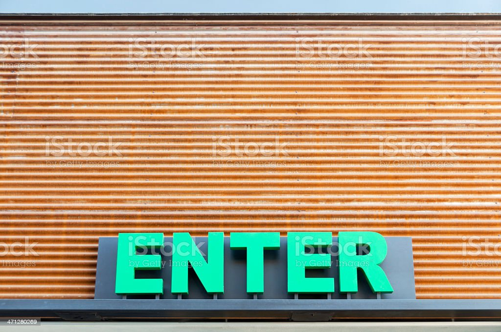 Enter Sign on Corrugated Metal royalty-free stock photo