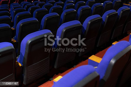 istock Enter the blue color for watching the movie. Placed in multiple locations in the theater. Taken from the back. 1153651167