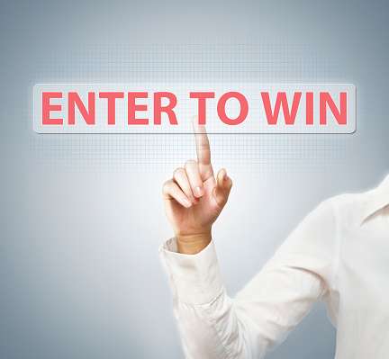 istock Enter to win / Touch screen concept (Click for more) 696481414