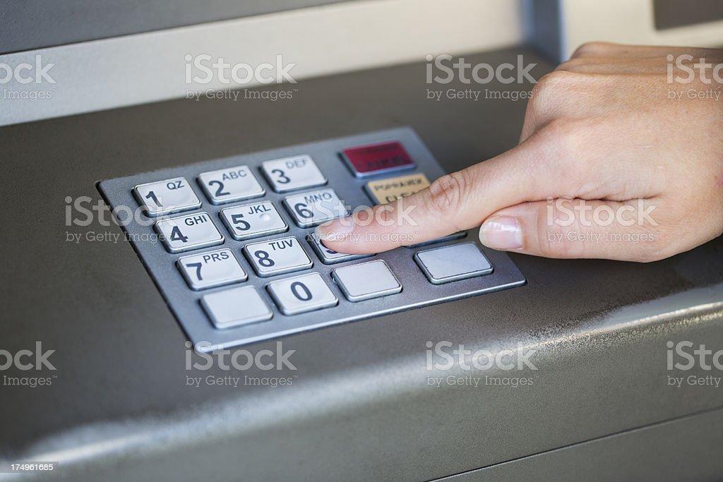 Entering Atm Cash Machine Pin Code Stock Photo - Download