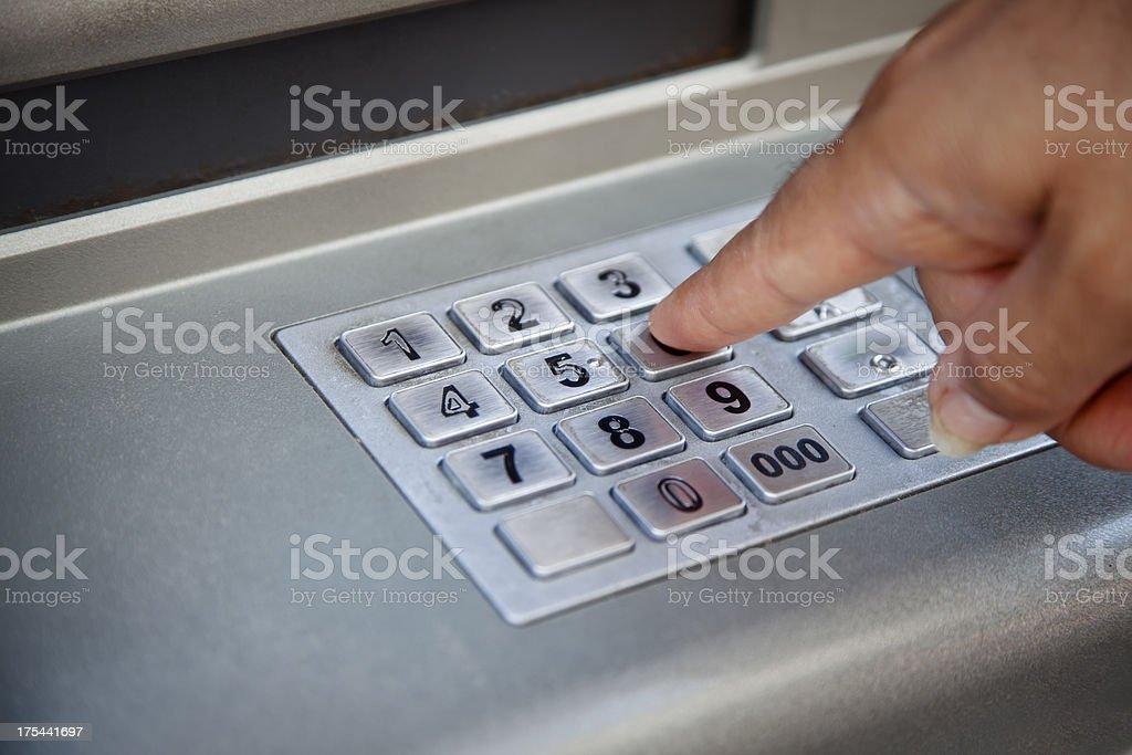 Entering atm cash machine pin code stock photo