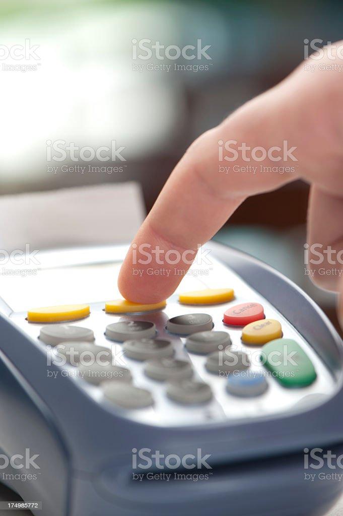 Entering customer credit card information on EFTPOS machine royalty-free stock photo