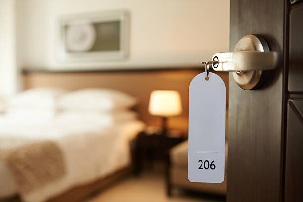 entering hotel room - hotels stock photos and pictures