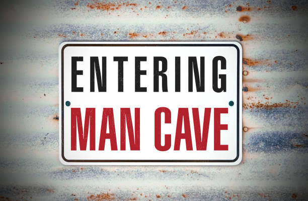 """Entering Man Cave A sign that says """"Entering Man Cave."""" man cave stock pictures, royalty-free photos & images"""